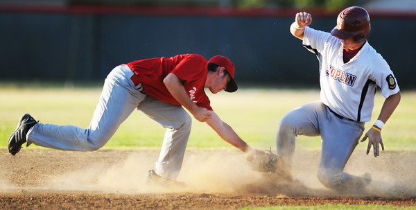 Globe/T. Rob Brown<br /> Webb City (16) attempts to tag out Joplin Miners runner (9) at second base Friday evening, July 20, 2012, during American Legion baseball championship tournament in Webb City. The runner was called safe on the play.