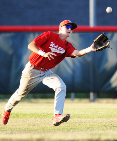 Globe/T. Rob Brown<br /> Webb City outfielder (17) reaches out for the ball Friday evening, July 20, 2012, during American Legion baseball championship tournament in Webb City.