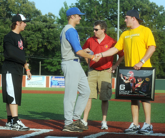 Globe/Roger Nomer<br /> (from left) Aaron Snow, Stuart Jeck, John Minton, from Jock's Nitch, and Zac Dickey gathered at home plate before Tuesday's game as Jock's Nitch presented a check for $600 from the sales of Zac Dickey's posters to the Tyler Jeck Foundation.