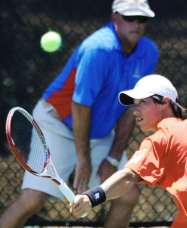 Globe/T. Rob Brown<br /> Daniel Yoo of Korea backhands the ball back to opponent Zhizhen Zhang of China during a Wednesday morning match, July 18, 2012, in the USTA Freeman $10,000 Men's Futures tennis tournament at Millenium Tennis and Fitness Club.