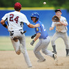 Globe/T. Rob Brown<br /> Joplin's Brett Graham (24) and second baseman catch Carthage runner Keaton Giett in a hot box during Thursday afternoon's American Legion District 15 Baseball tournament, July 26, 2012, at Carthage's Carl Lewton Stadium.