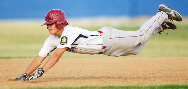 Globe/T. Rob Brown<br /> Joplin runner #3 starts the dive to second base against Hillcrest during Thursday afternoon's American Legion District 15 Baseball tournament, July 26, 2012, at Carthage's Carl Lewton Stadium.