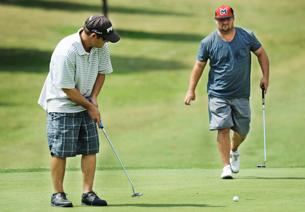 Globe/T. Rob Brown<br /> Tony Armstrong, of Joplin, putts as Will Parnell, of Anderson, looks on Saturday afternoon, July 14, 2012, during the Ozark Amateur on the eighteenth hole at Schifferdecker Golf Course.