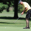 Globe/Roger Nomer<br /> Dennis Deel putts during Saturday's Twin Hills Invitational.