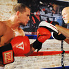 "Globe/T. Rob Brown<br /> Jesse ""Left Hook"" Cook of Seneca practices with his father Dallas Cook, head trainer, while training at Heartland Boxing Gym in downtown Galena, Kan., recently."