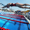 Globe/Roger Nomer<br /> Lamar's Kaelyn Sturgell, 15, dives in to start the 200-yard freestyle during the Joplin Invitational at Schifferdecker Pool on Saturday.
