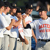 Globe/Roger Nomer<br /> Midwest Nationals Tristian Cavalli, right, greets his teammates during the starting lineup as the all sport Baxter Whiz Kids jerseys during pool play at the Premier Baseball Tournament at Joe Becker Stadium on Wednesday.