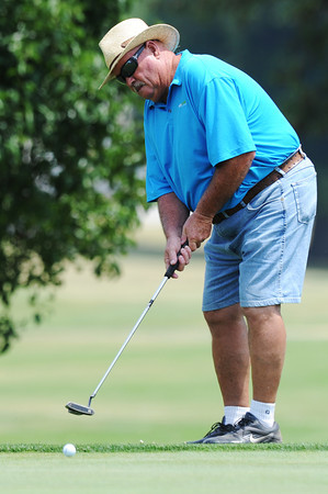 Globe/Roger Nomer<br /> Tom Wade putts at Schifferdecker Golf Course on Saturday.