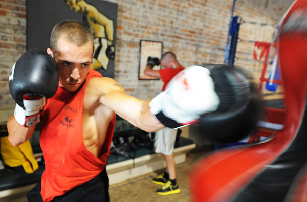 """Globe/T. Rob Brown<br /> Dillon """"White Lightning"""" Cook of Seneca practices on a double end bag while training at Heartland Boxing Gym in downtown Galena, Kan., recently."""
