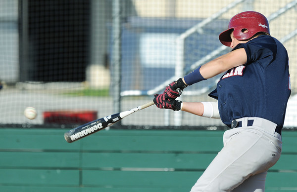 Globe/Roger Nomer<br /> Joplin's (24) hits an RBI single during the first game of a double header against Webb City on Thursday at Barnes Field.