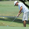 Globe/Roger Nomer<br /> Jackson Boyer, Joplin, chips onto the green at Schifferdecker Golf Course on Saturday.
