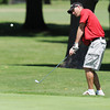 Globe/Roger Nomer<br /> Joe Gunnels, Drexel, chips onto the green during Saturday's Twin Hills Invitational.
