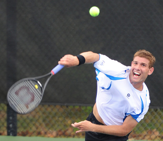 Globe/T. Rob Brown<br /> Eric Quigley, No. 3 seed, serves the ball to opponent Nick Chappell, both United States, during Wednesday afternoon's match, July 17, 2013, of the USTA Freeman $10,000 Men's Futures at Millennium Tennis Club.