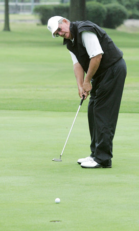 Globe/Roger Nomer<br /> Bob Fouke, Broken Arrow, putts during the Twin Hills Invitational on Friday.