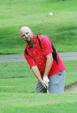 Globe/Roger Nomer<br /> Marshall Wesson, Broken Arrow, hits out of a muddy bunker during the Twin Hills Invitational on Friday.