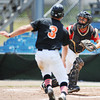 Globe/T. Rob Brown<br /> Houston Raiders White catcher Brock Morgan heads to the throw as Oklahoma Fuel 17U runner Jordan Payne runs home Thursday afternoon, July 18, 2013, at Joe Becker Stadium. The runner was safe at the plate.