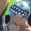 Globe/Roger Nomer<br /> Grayson Manning, 8, Siloam Springs, sports a fearsome hat but nervously watches his teammates compete in a relay during the Joplin Invitational at Schifferdecker Pool on Saturday.