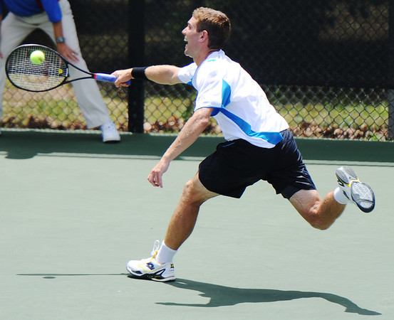 Globe/T. Rob Brown<br /> Eric Quigley, No. 3 seed, stretches to reach the ball as he plays against opponent Nick Chappell, both United States, during Wednesday afternoon's match, July 17, 2013, of the USTA Freeman $10,000 Men's Futures at Millennium Tennis Club.