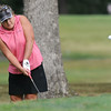 Tammy Thomas hits a chip shot onto the No. 8 green during the Women's Tri-State Tournament on Tuesday at Briarbrook.<br /> Globe | Laurie Sisk