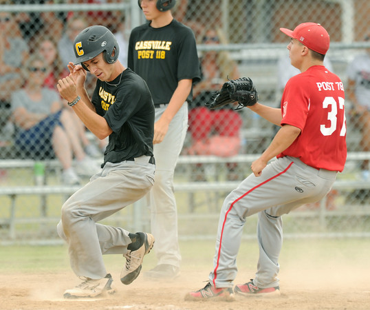 CAssville's xx xxx (1) ducks to avoid the catcher's throw to home while scoring on a passed ball during their game against Carl Junction on Wednesday at Carl Junction. Fielding the throw is Carl Junction pitcher xx xxx (37).<br /> Globe | Laurie Sisk