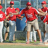Globe/Roger Nomer<br /> Webb City coaches celebrate a strike out during Monday's 9-10-year-old Little League Championship at Sunny Jim Field.