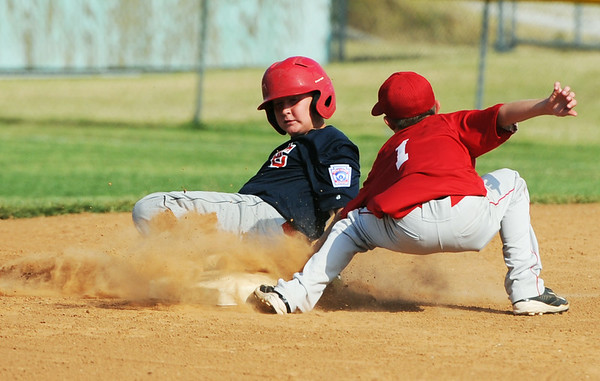Globe/Roger Nomer<br /> Jefferson City's Tyler Renn slides safely into second under a tag by Webb City's Matt Woodmansee during Monday's 9-10-year-old Little League Championship at Sunny Jim Field.