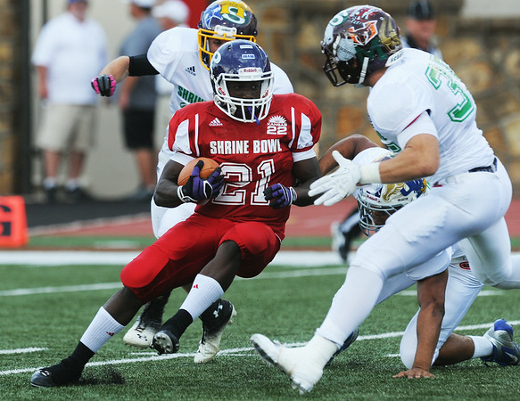 Globe/Roger Nomer<br /> East's Ethan Paul-Davis, Pittsburg High School, looks for running room during a kick return during the first quarter of the Kansas Shrine Bowl at Pittsburg State University's Carnie Smith Stadium in Pittsburg, Kan., on Saturday, July 26, 2014.