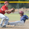 Joplin's will Sitton slides safely into second base as Carl Junction's xx xxx (4) waits for the throw during Joplin's game against Carl Junction on Saturday at Carl Junction.<br /> Globe | Laurie Sisk