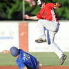 Outlaws shortstop Enrique Fino leaps to field an errant throw as Nevada's Cooper Burton slides safely beneath him during their game on Thursday night at Jaycee Ball Park in Pittsburg.<br /> Globe | Laurie Sisk