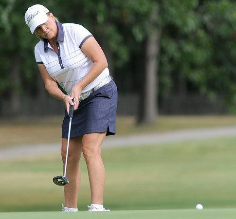 Jill West watches her putt roll toward the hole on the No. 8 green during thew Women's Tri-State Tournament on Tuesday at Briarbrook.<br /> Globe | Laurie Sisk