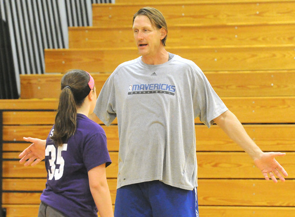 Greg Dreilling discusses transition defense with Thomas Jefferson camper Katie Scott during their camp on Tuesday.<br /> Globe | Laurie Sisk