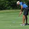 Globe/Roger Nomer<br /> Todd Doss putts during Friday's Twin Hills Invitational.