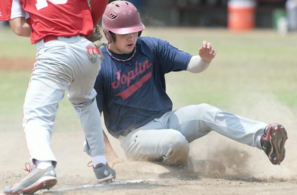 Joplin's xx xxx (29) slides safely into third base after hitting a triple against Webb City  during their game on Friday at Carl Junction.<br /> Globe   Laurie Sisk