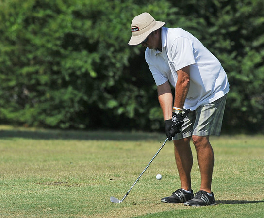 Globe/Roger Nomer<br /> Mike Samuelson hits a shot onto the green during Friday's Twin Hills Invitational.