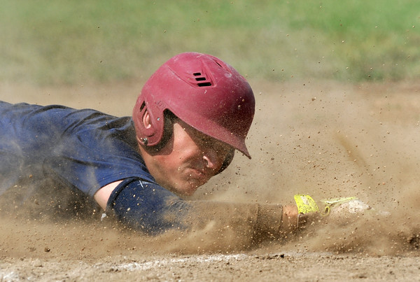 Joplin starting pitcher Tristan Ash helps out his own cause as he slides into third base with an rbi triple during Joplin's game against Carl Junction on Saturday at Carl Junction.<br /> Globe | Laurie Sisk