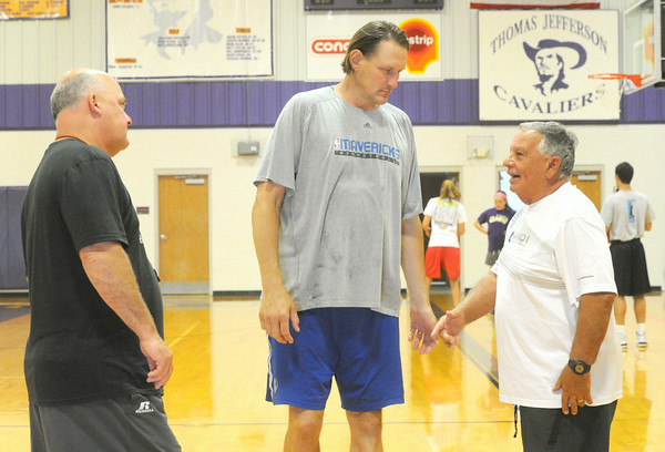 From the left: Chris Davis, Greg Dreilling and Thomas Jefferson caoch XXX XXX chat during a girls basketball camp on Tuesday at the school.<br /> Globe | Laurie Sisk
