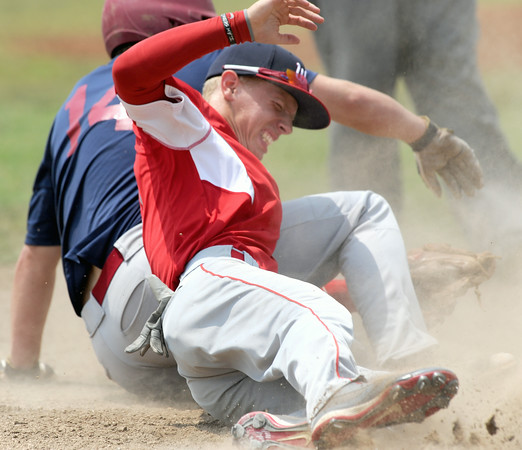 Webb City's xx xx (14) winces as he collides with Joplin's xx xxx (14) at third base during their game against Jopin on Friday at Carl Junction.<br /> Globe   Laurie Sisk