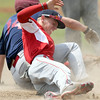 Webb City's xx xx (14) winces as he collides with Joplin's xx xxx (14) at third base during their game against Jopin on Friday at Carl Junction.<br /> Globe | Laurie Sisk