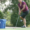 Esther Alumbaugh tries to coax her ball into the hole on the no. 9 green  during the Women's Tri-State Tournament on Tuesday at Briarbrook.<br /> Globe | Laurie Sisk
