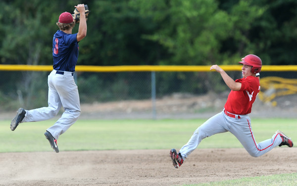 Joplin's Chris Leonardi jumps to try and catch an errant throw as Carl Junction's xx xxx (37) approaches second base during Joplin's game against Carl Junction on Saturday at Carl Junction.<br /> Globe   Laurie Sisk