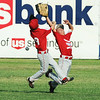Globe/Roger Nomer<br /> Webb City's Blake Kanghman, 9, and Gawing Stowell collide as they go for a pop fly during Monday's 9-10-year-old Little League Championship at Sunny Jim Field.