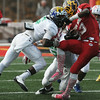 Globe/Roger Nomer<br /> West's DeSean Washington (6), Maize South High School, tackles East's James Newton (13), Field Kindley High School during the first quarter of the Kansas Shrine Bowl at Pittsburg State University's Carnie Smith Stadium in Pittsburg, Kan., on Saturday, July 26, 2014.