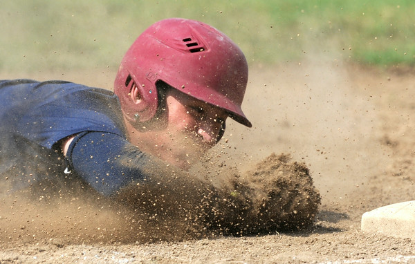 Joplin starting pitcher Tristan Ash helps out his own cause as he slides into third base with an rbi triple during Joplin's game against Carl Junction on Saturday at Carl Junction.<br /> Globe   Laurie Sisk