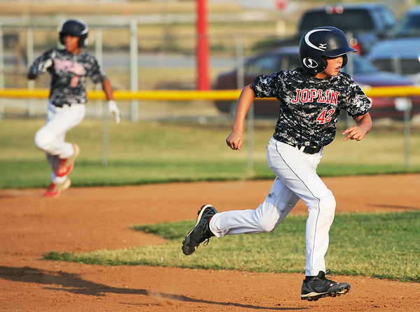 Globe/Roger Nomer<br /> Joplin's Holden Ledford rounds second to score during Monday's 11-12-year old Little League Championship at Sunny Jim Field.