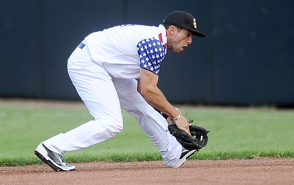 Blasters second baseman Sergio Leon handles a ground ball during Joplin's game against the Wichita Wingnuts on Friday night at Joe Becker Stadium.<br /> Globe | Laurie Sisk