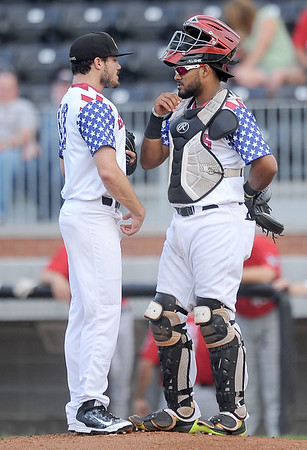 Blasters catcher Charlie Villanueva confers with starting pitcher Ethan Rosebeck after Rosebeck gave up his second homerun during Joplin's game against the Wichita Wingnuts on Friday night at Joe Becker Stadium.<br /> Globe | Laurie Sisk