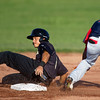 Joplin's Oscar Mesa slides safely past the tag of Lincoln's Dainer Moreira during the Blasters' game against the Saltdogs on Friday night at Joe Becker Stadium.<br /> Globe | Laurie Sisk