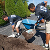 From the left: Premier Baseball players Josh Lamb, 18 and Austin Upshaw, 18, of the Houston C2 team, help with yardwork at the Ronald McDonald House on Thursday afternoon. C2 (Commit to Charity) teams are required by their league to commit to charitable projects each summer.<br /> Globe | Laurie Sisk