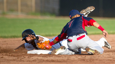 Joplin's Sergio Leon reaches for the bag but is tagged out by Lincoln's Dainer Moreira on a steal attempt during the Blasters' game against the Saltdogs on Thursday night at Joe Becker Stadium. Globe   Laurie Sisk