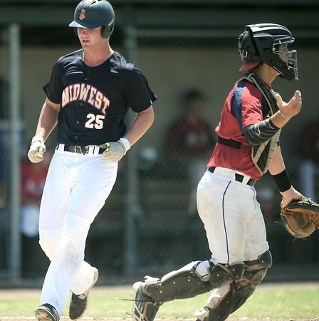 MIdwest Nationals' Mark Duley steps on the plate for his team's first run during a game in the Premier Baseball tournament on Saturday at Wendell Redden Field.<br /> Globe   Laurie Sisk